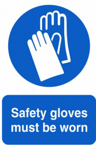 A warning sign stating that gloves must be worn.